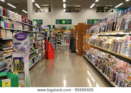 Port Coquitlam, BC Canada - March 17, 2015 : A section display magazines from shelf in supermarket