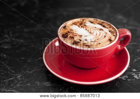 Cappuccino coffee in red cup