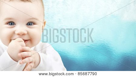child, people and happiness concept - adorable baby