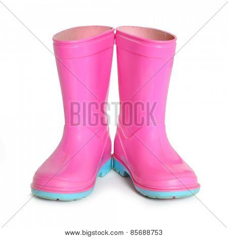 Pink gumboots on white background.