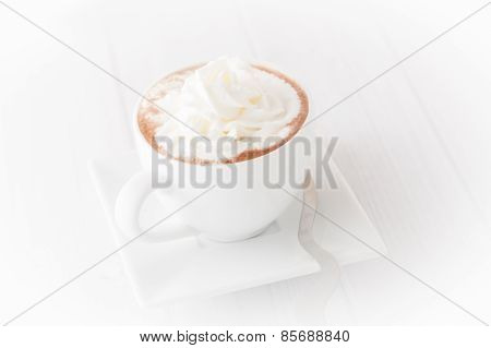A Cup Of Coffee With Wheap Cream, Isolated, Vignetted