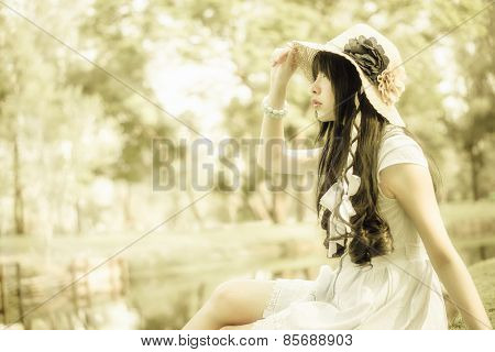 A Cute Asian Thai Girl Is Looking In The Sky With Hope In Natural Atmosphere In Creamy Style