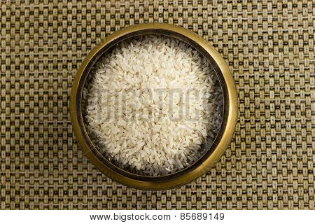 White Rice kept in a bowl on a plain background
