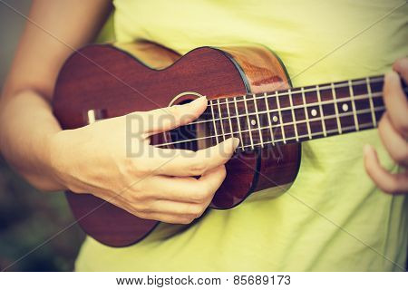 Woman Playing Ukulele, Vintage Style.