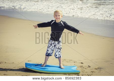 Happy Young boy having fun at the beach on vacation,