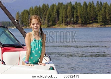 Girl riding a motorboat on a beautiful lake