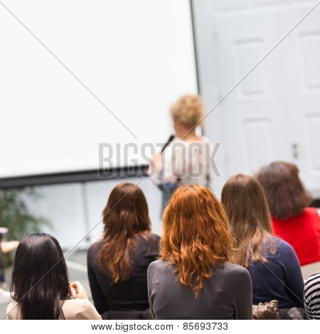 Woman lecturing at university.