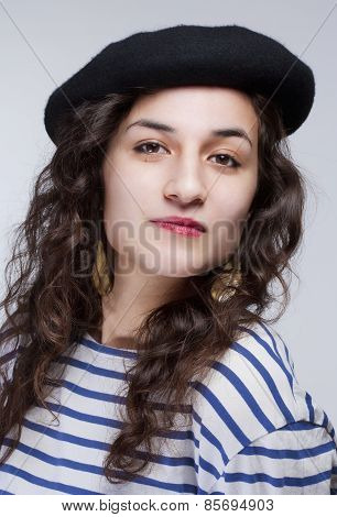 Portrait Of A Young Woman With Barrett Hat And Striped T-shirt