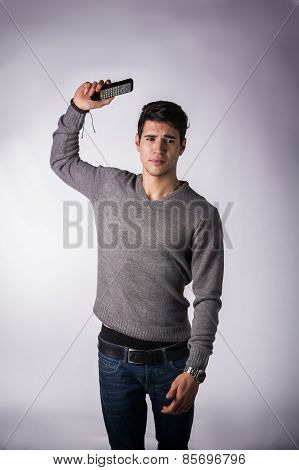 Attractive Young Man Throwing Away Remote Control