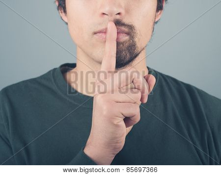 Man With Half Beard And Finger On Lips