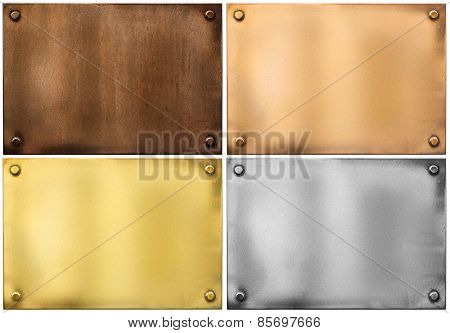 four various metal plates or plaques with rivets isolated on white including silver, brass or gold, bronze and rusty one