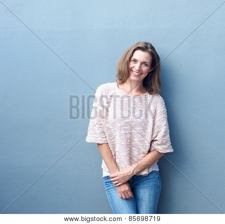 Attractive Mid Adult Woman Smiling On Gray Background
