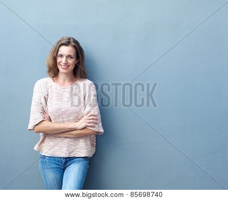 Happy Mid Adult Woman Smiling With Arms Crossed
