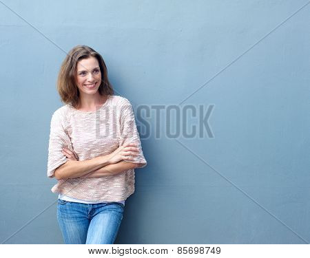 Smiling Mid Adult Woman Standing With Arms Crossed