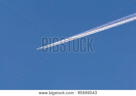 White Jet Trail In Blue Sky.