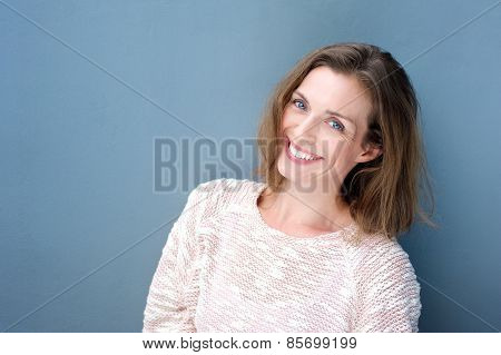 Attractive Smiling Mid Adult Woman On Blue Background