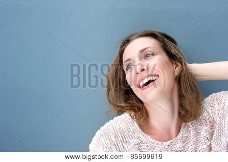 Happy Attractive Older Woman Smiling With Hand In Hair