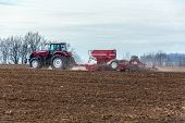 stock photo of potato-field  - The tractor working on the large field - JPG
