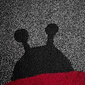 picture of linoleum  - The silhouette of a ladybug on linoleum - JPG