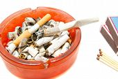 image of butts  - matches butts and cigarette on white background closeup - JPG