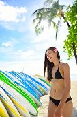 stock photo of waikiki  - Bikini beach woman at surfboard rental surf shop - JPG