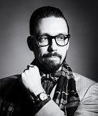 foto of bow tie hair  - Fashionable handsome stylish bearded man with glasses and in a checkered scarf and bow tie - JPG