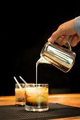 image of marsala  - Preparation of white russian cocktails on the bar counter on rubber mat - JPG