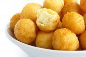 image of dauphin  - Bowl of fried small potato balls on white - JPG