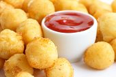 picture of dauphin  - Bowl of fried small potato balls on white - JPG