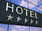 foto of modern building  - The hotel with a five stars sign on the modern building facade - JPG