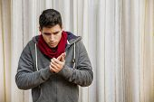 picture of flu shot  - Sick young man with flu or cold wearing scarf and winter clothes - JPG