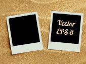 stock photo of polaroid  - Summer like retro style empty polaroid photo cards lying on a sea sand - JPG