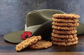 picture of biscuits  - Australian Anzac biscuits with soldier slouch hat on dark vintage background - JPG