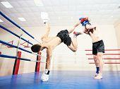 picture of boxing ring  - combat sport muai thai sportsman fighting at training boxing ring - JPG