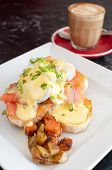 picture of benediction  - Close up of a plate of delicious eggs benedict with salmon and saut - JPG