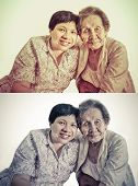 stock photo of niece  - Family Portrait of an Asian elder mother and daughter hugging in isolated backgroud in retro color set - JPG