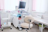 foto of diagnostic medical tool  - Interior of medical room with ultrasound diagnostic equipment - JPG