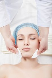 picture of cleanse  - Woman getting face treatment in medical spa center - JPG