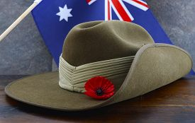 stock photo of flags world  - Anzac army slouch hat with Australian Flag on vintage wood background - JPG