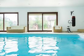 stock photo of enormous  - Enormous luxury residence with interior swimming pool - JPG