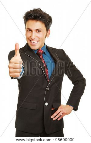 Cheering happy business man holding thumbs up