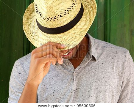 Happy Man With Hat Smiling And Looking Down