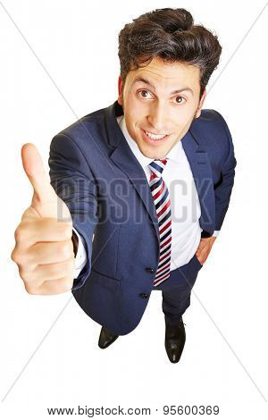 Smiling business man holding thumb up for motivation