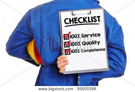 Worker with checklist for quality and service on a clipboard