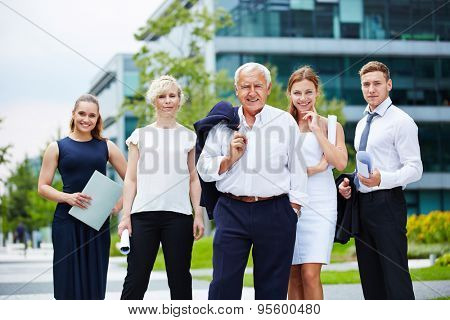 Portrait of business team with senior manager in summer