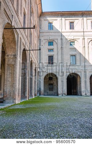 Archway, Columns, Courtyard And Cobblestones In Palace Of Pilotta, Parma -italy