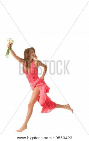 Sexual woman in jump with flowers in hands