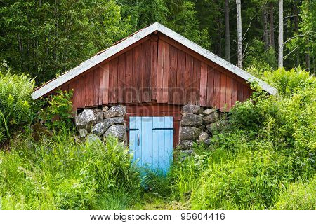 Small Red Outside Barn Covered Built Into The Ground