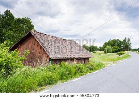 Old Worn Red Barn Near Road