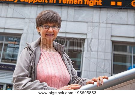 Pension age good looking woman portrait in the City